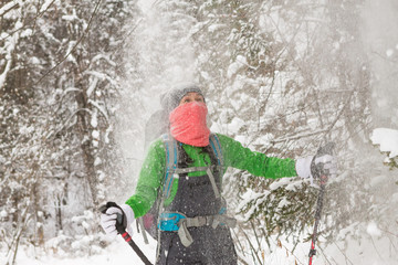 On Woman pours a lot of snow from tree