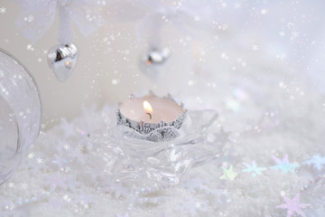 Christmas candle on a festive background