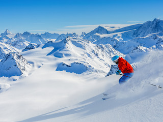 Skiing with amazing view of swiss famous mountains in beautiful