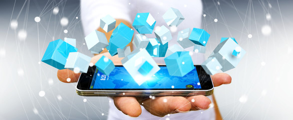Businessman holding flying blue shiny cube 3D rendering