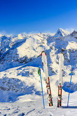 Ski equipment with amazing view of swiss famous mountains in beautiful winter snow. The matterhorn and the Dent d'Herens. In the background Castor and Pollux. View mrom Mt Fort