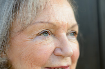 Close up of the blue eyes of an elderly lady