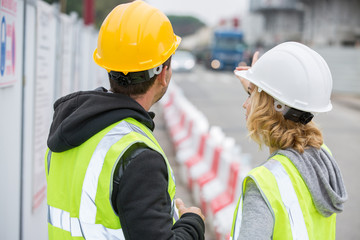 Construction people looking at construction site
