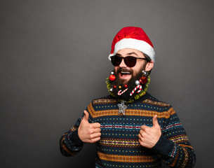 bearded man with decorated beard showing ok sign
