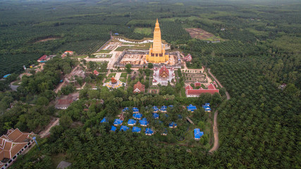 the highest pagoda in the world.pagoda has gold color..the temple and pagoda are building in the large field in the embrace of the mountains.