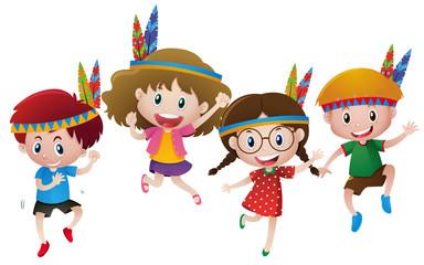 Four kids wearing indians headband