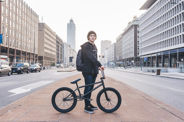 Young guy riding bmx backlight