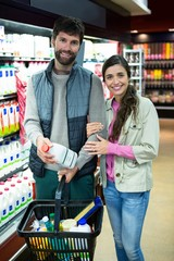 Portrait of couple shopping in grocery section
