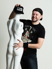 Expressive young rocker man posing with dummy