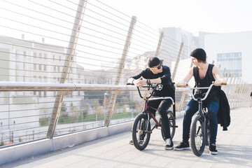 Two young guys outdoor riding bmx