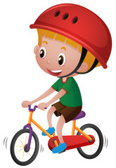 Boy riding bicycle with his helmet on