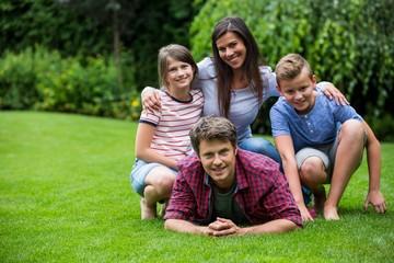 Happy family smiling in park