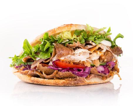 close up of kebab sandwich.
