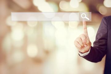 Businessman hand touching blank search bar over blur background - fototapety na wymiar