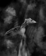 woman with closed eyes flyng up in night clouds, monochrome image