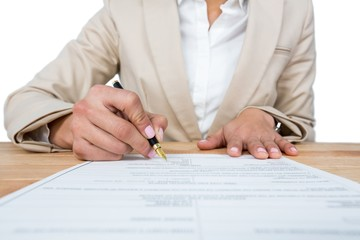 Mid section of businesswoman filling mortgage contract form