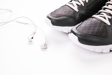 running shoes and headphones on a white background. Sportswear.