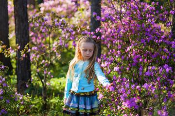 cute little girl in apple blossom spring day