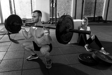 Serious strong man lifting weight