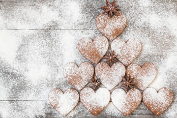 Christmas heart shaped cookies with sugar powder. Stylized like a fir tree. Top view.