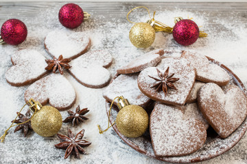 Christmas heart shaped cookies with sugar powder. Christmas decoration.