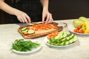 Woman's hands cutting vegetables.
