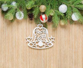 Christmas bell on bamboo background
