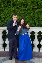 Cheerful couple at the wedding of friends