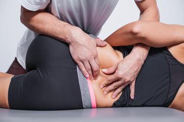 Professional back massage in spa studio.