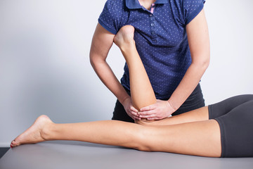 Professional leg massage in spa studio