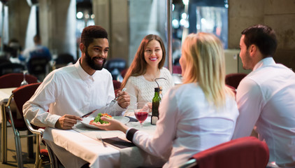 middle class people enjoying food in cafe terrace
