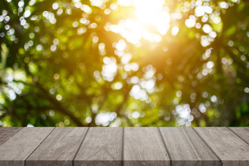 Empty top wooden table and sunny blurred bokeh background for product display
