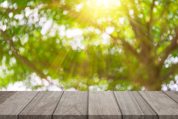 Empty top wooden table and sunny blurred bokeh background
