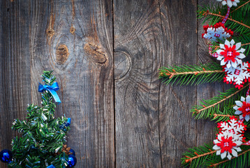 Christmas background with fir branches  on a gray wooden backgro