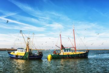 Fishing trawlers at work