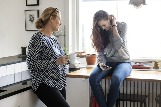 Mother with daughter in kitchen