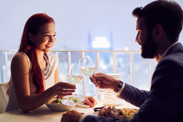 Young couple at restaurant having dinner