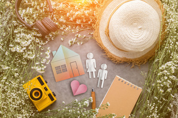 home concept with house shape paper cut with frame of nature tre