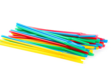 pile of plastic cocktail straws to consumption of drinks