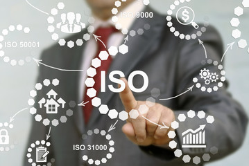 ISO or The International Organization for Standardization concept presented by businessman touching on virtual screen - image element furnished by NASA.