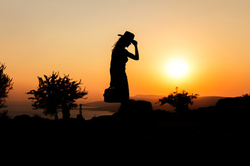 Silhouette capture of a woman wearing cowboy hat