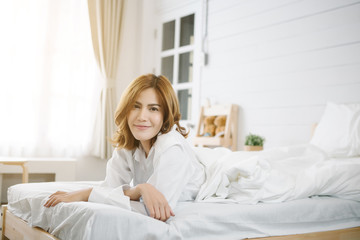 Smiling Asia woman on the bed