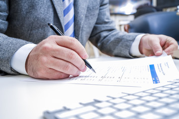 Businessman checking out reports at the office table.Business and education concept Reading financial documents