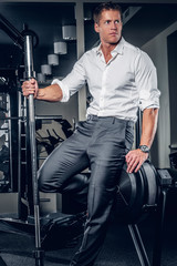 Elegant, attractive male posing in a gym club.