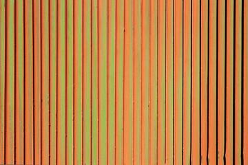 Orange rusty green background. Corrosion of metal iron.