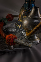 Nargile-Hookah With Engraved Equipment in Close up View and Dark Environment