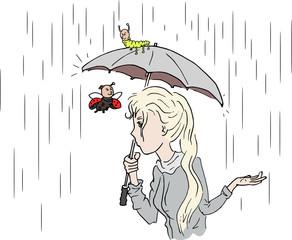 Vrouw in de regen met paraplu