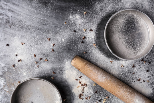 Baking preparation - rolling pin, pots and pans and flour supplies.