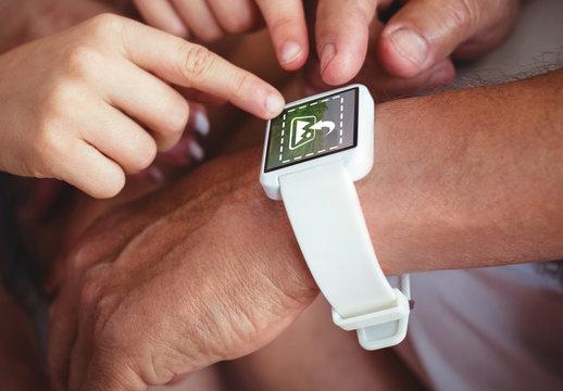 Close Shot of Users Surrounding Smartwatch Mockup