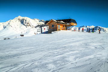 Cable car station and skiers,Alpe d Huez,France,Europe